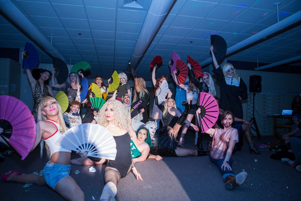 The Critical Drag class poses on stage while waving colorful fans as part of the last number during the class's fnal performance at the Tisch Library in 2018.